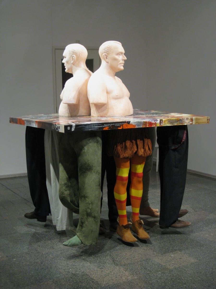 """""""ROLLIMÄNG: ANDRES DVINJANINOV"""" 2009 elusuuruses figuraalne kineetiline installatsioon: plastik,puit, kostüümid,mannekeenid,metall,puit,paber, mootorid jm Jalad horisontaalse pinna all liiguvad, kostub Andrese hääl  <br/>""""ROLE PLAY: ANDRES DVINJANINOV"""" 2009 lifesize, kinetic figurative installation: plastic,mannequins,costumes,wood,metal,paper,engines etc The legs in costumes under the horisontal surface are moving, you can hear Andres´s voice"""