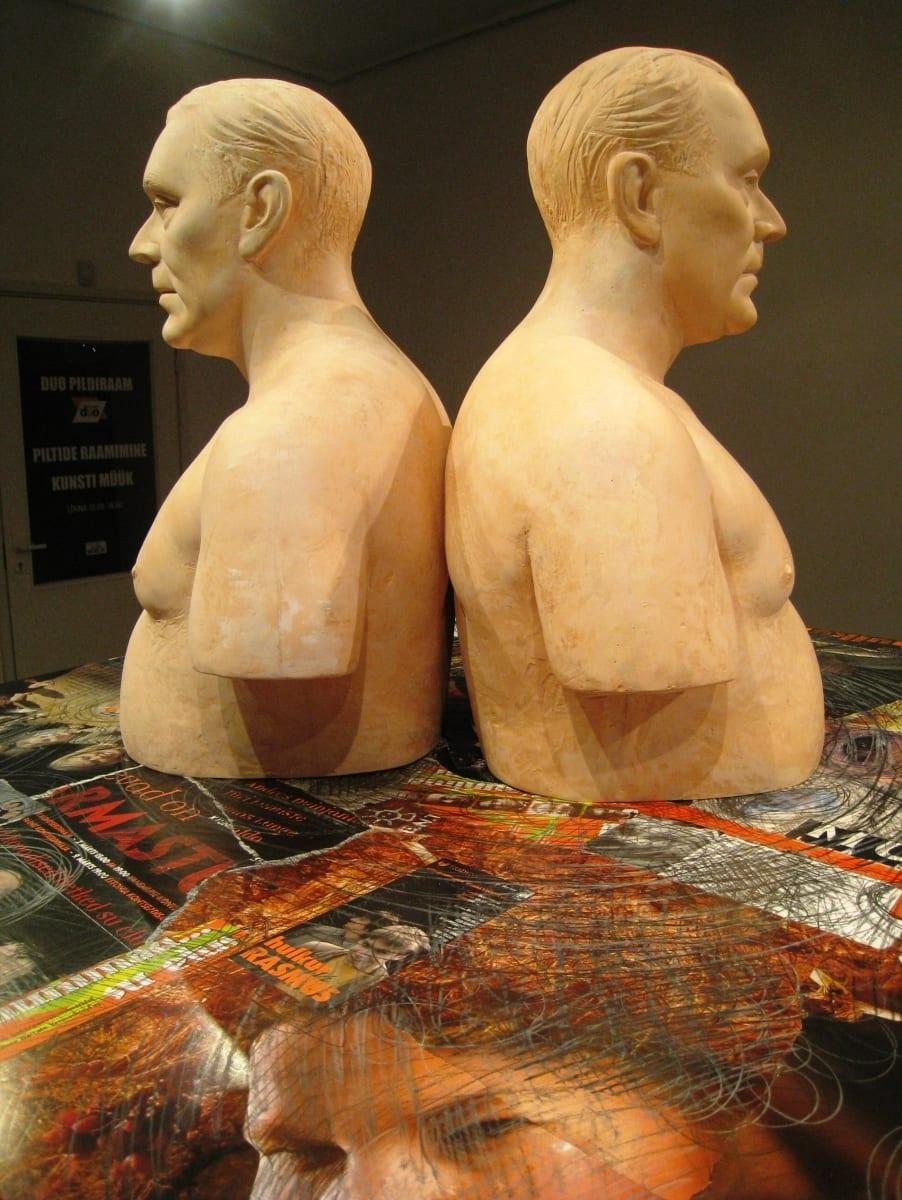 """""""ROLLIMÄNG: ANDRES DVINJANINOV"""" 2009 elusuuruses figuraalne kineetiline installatsioon: plastik,puit, kostüümid,mannekeenid,metall,puit,paber, mootorid jm Jalad horisontaalse pinna all liiguvad, kostub Andrese hääl <br/> """"ROLE PLAY: ANDRES DVINJANINOV"""" 2009 lifesize, kinetic figurative installation: plastic,mannequins,costumes,wood,metal,paper,engines etc The legs in costumes under the horisontal surface are moving, you can hear Andres´s voice"""