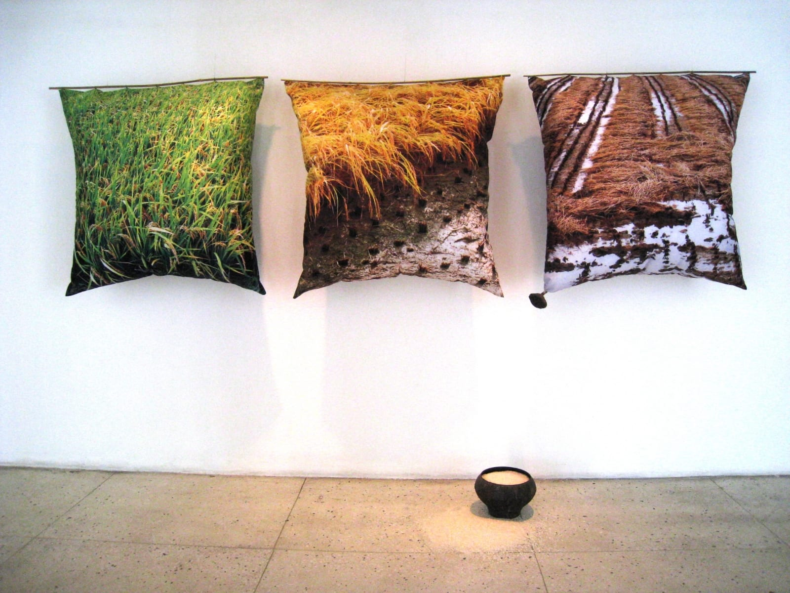 """HOMMAGE EMAKESELE RIISILE"" installatsioon 2011  3 patja mõõdus 1m x1mx 30cm kangale trükitud Korea riisipõldude fotod,padjatäidis,bambuspulk,riis,metall<br/> ""HOMMAGE to MOTHER RICE"" installation 2011  3 pillows measures 1mx1mx30cm photos of rice fields in South Korea printed on cancas, pillowfill,bamboo,rice,metal"